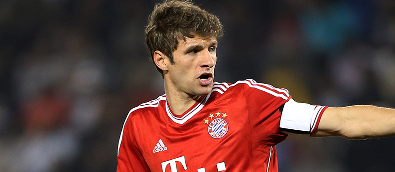 Thomas Muller insists he is happy at Bayern Munich despite Manchester United interest