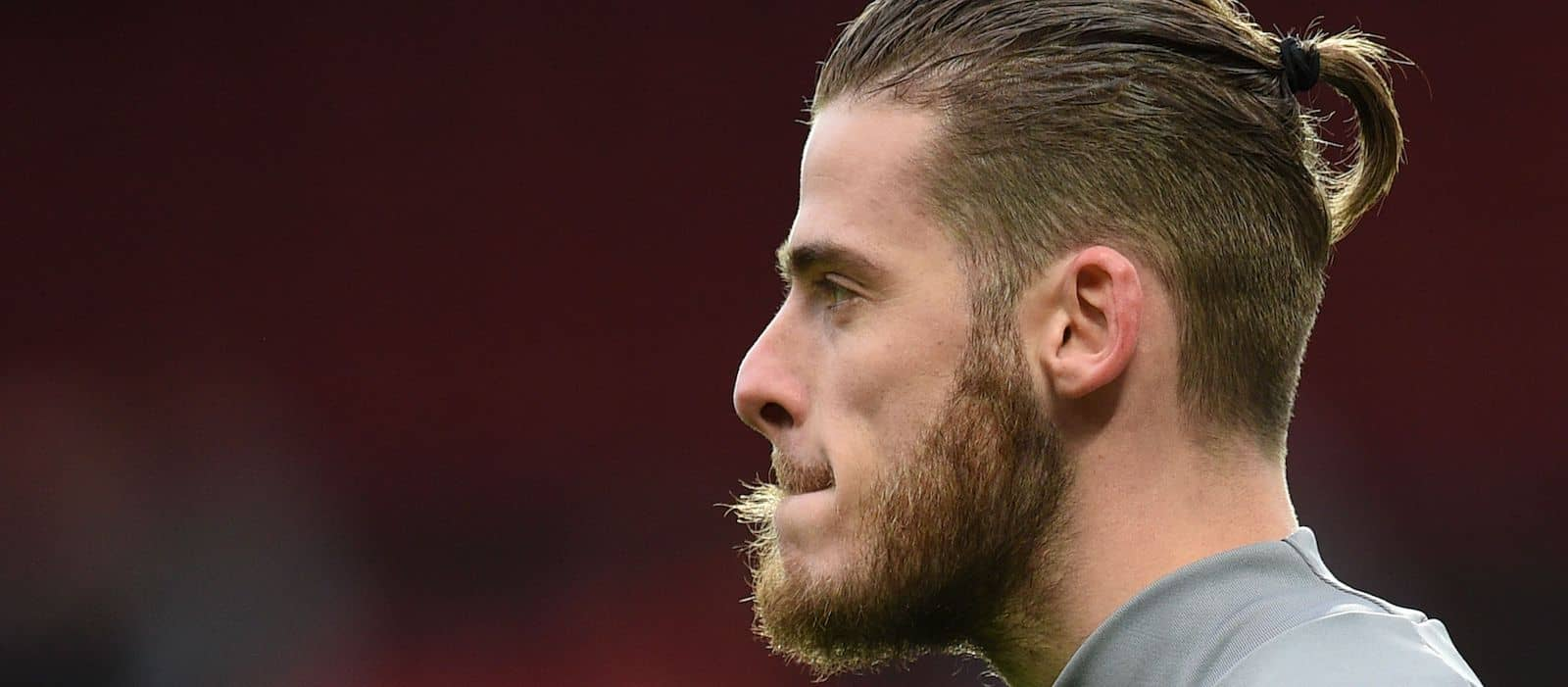 David de Gea celebrates while Man United fans are crying